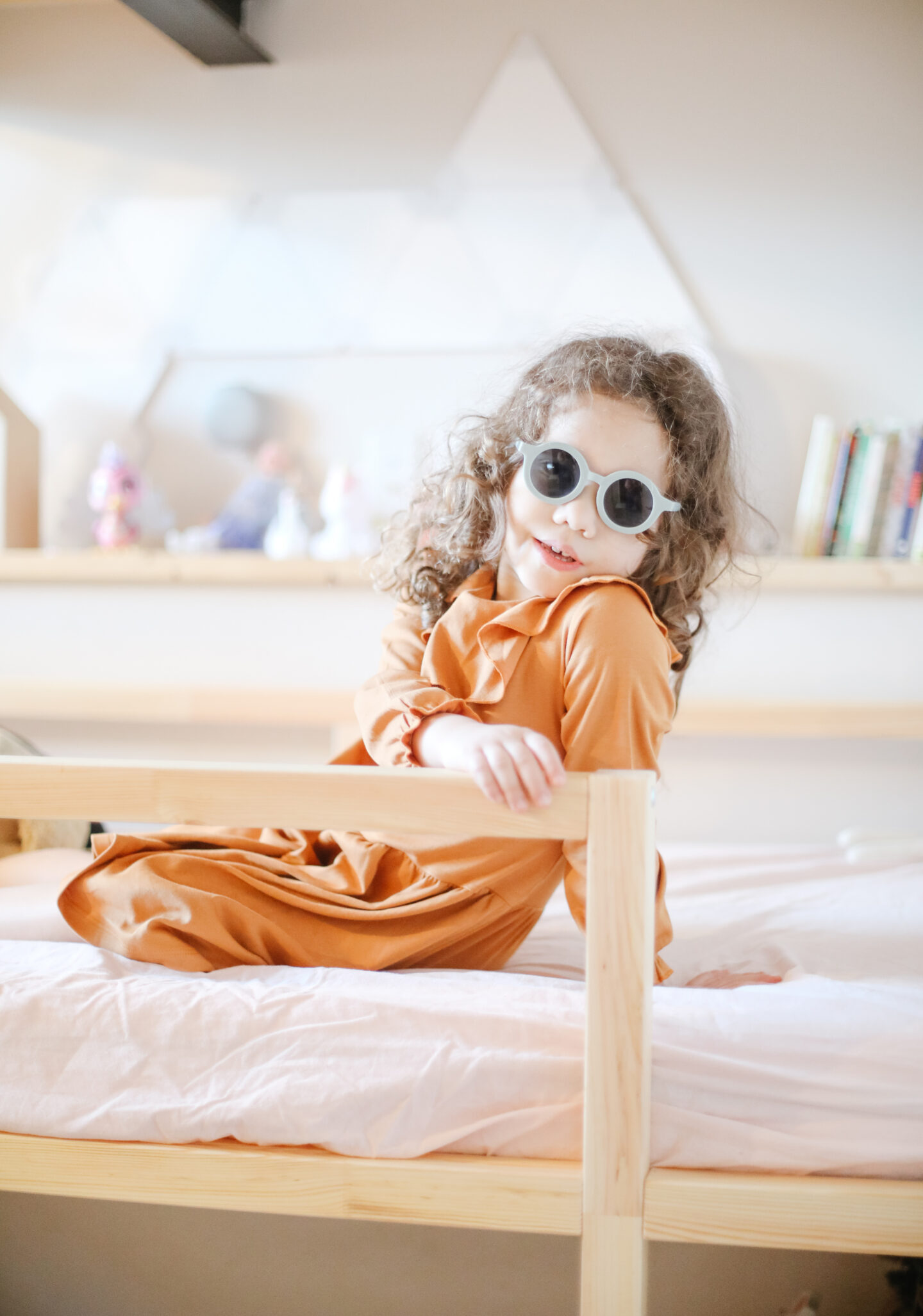 a toddler girl posing with sunglasses