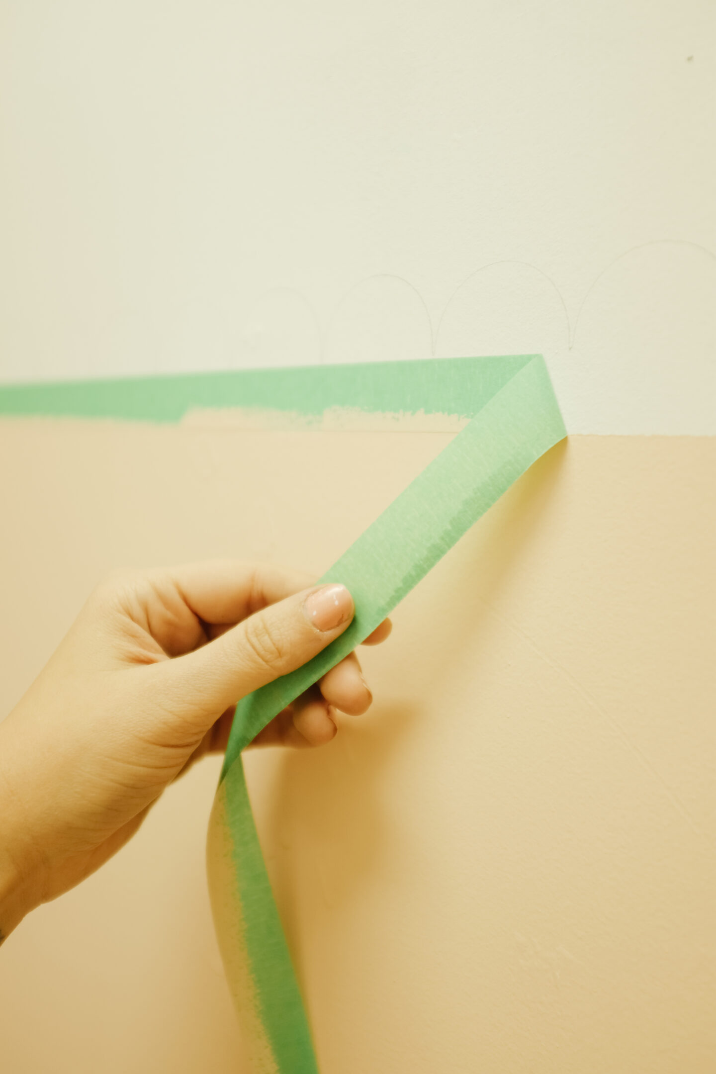 Removing painters tape in a scalloped wall DIY