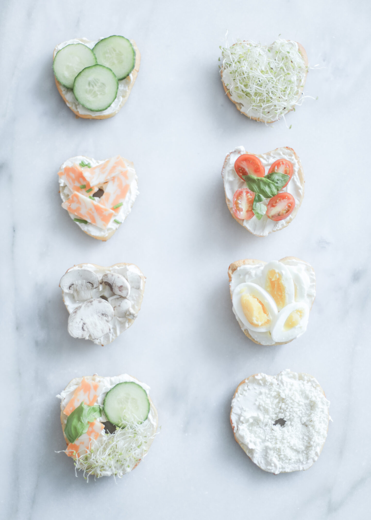 heart bagels with different toppings